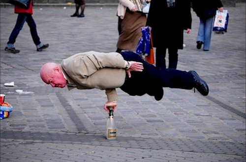 man balancing bottle