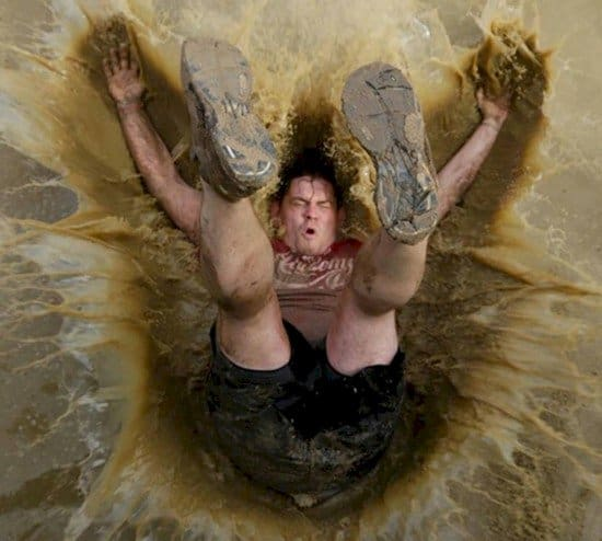 man falling into muddy pool