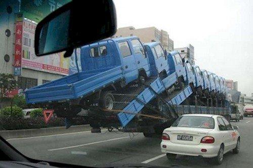 trucks balanced over road