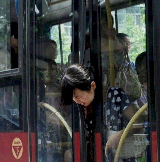 woman head stuck bus