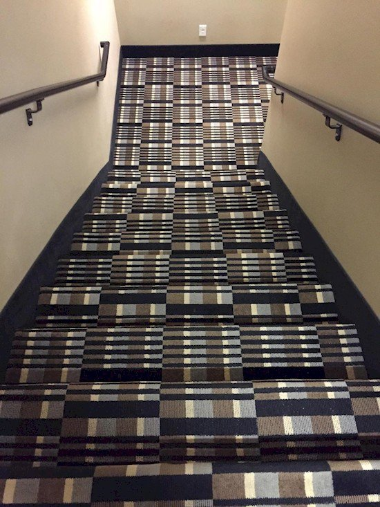 wonky carpeted stairs