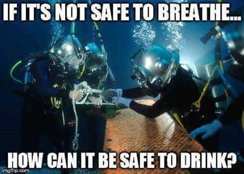 underwater divers sawing something with water
