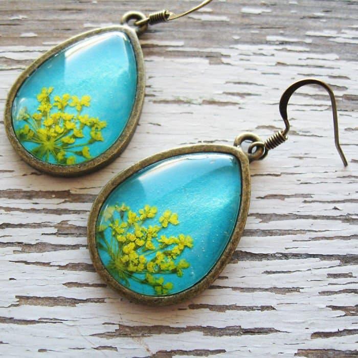 blue-oval-earrings-yellow-flower