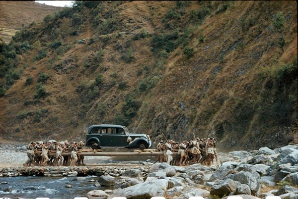 historical-photos-porters-move-car-across-river-nepal-1948