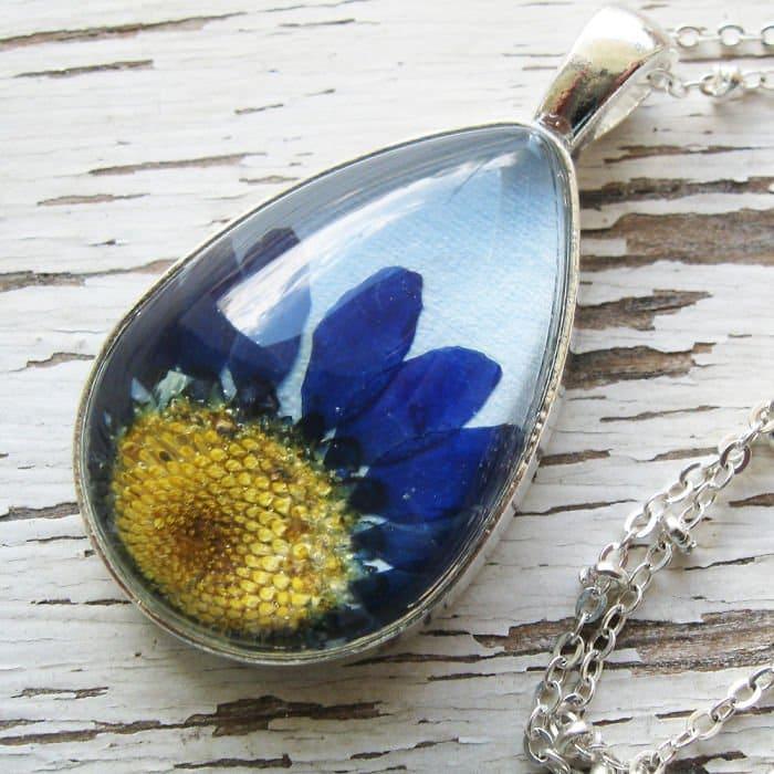 light-blue-oval-yellow-blue-flower