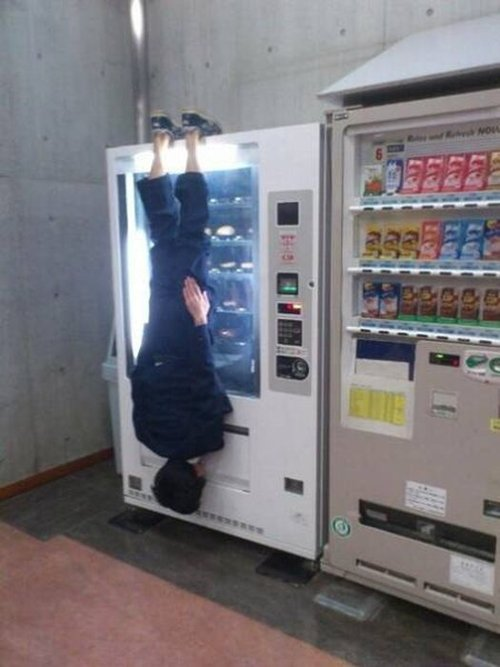 only-in-asia-hanging-from-vending-machine