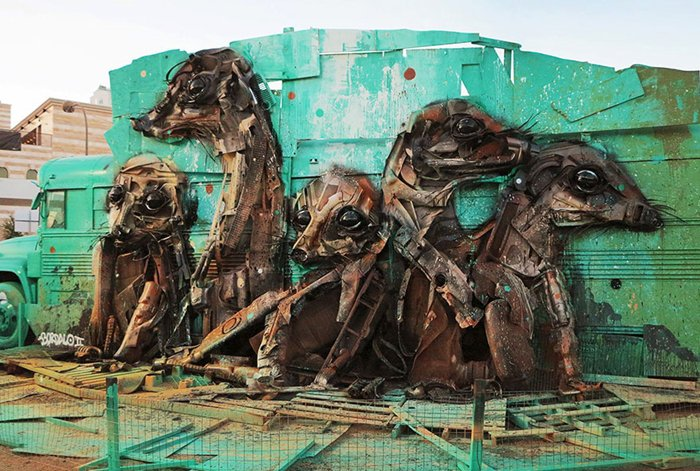 trash-animal-sculpture-artur-bordalo-bus-backdrop-meercats