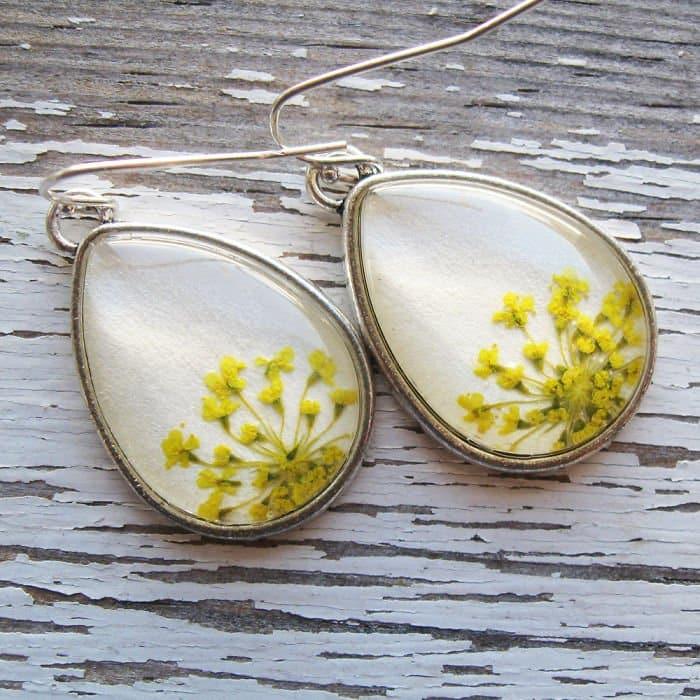 white-oval-earrings-yellow-flowers
