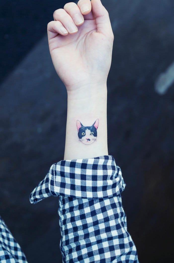wrist tattoo cat