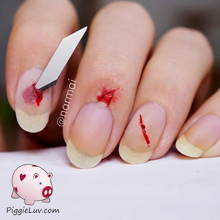 halloween-creepy-nail-art-stab-cuts