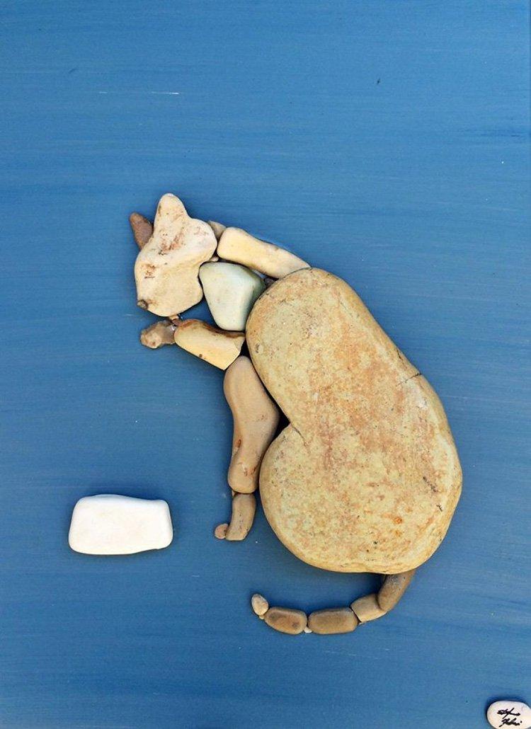 cat-licking-paws-stone-art