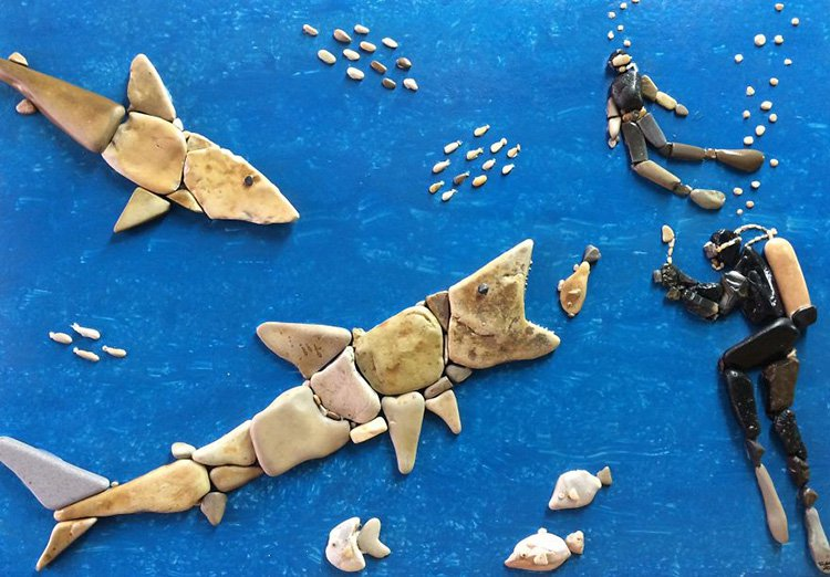 divers-and-shark-stone-art