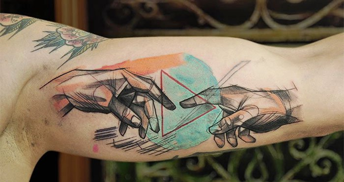 The Creation Of Adam Michelangelo bicep tattoo