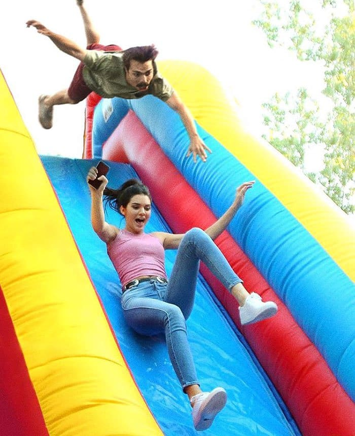 guy-photoshops-himself-into-kendall-jenner-photo-going-down-bouncy-slide