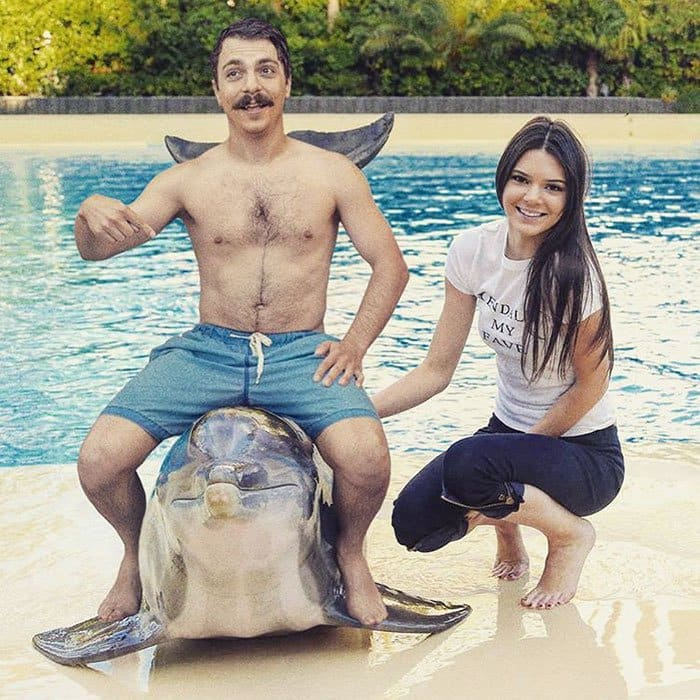guy-photoshops-himself-into-kendall-jenner-photo-sitting-on-dolphin