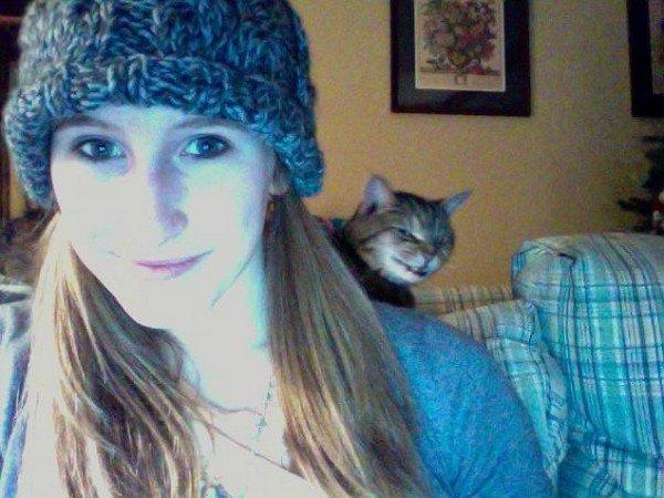 evil cats girl photobomb