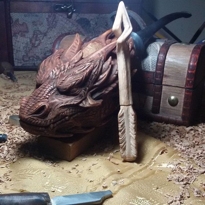 hand carved dragon pipe and arrow