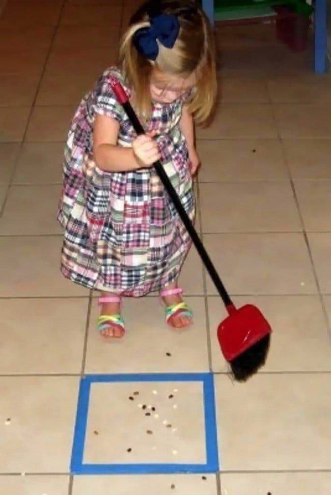 kid sweeping