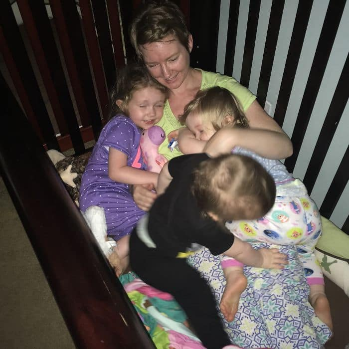 mom realities cuddle time in crib