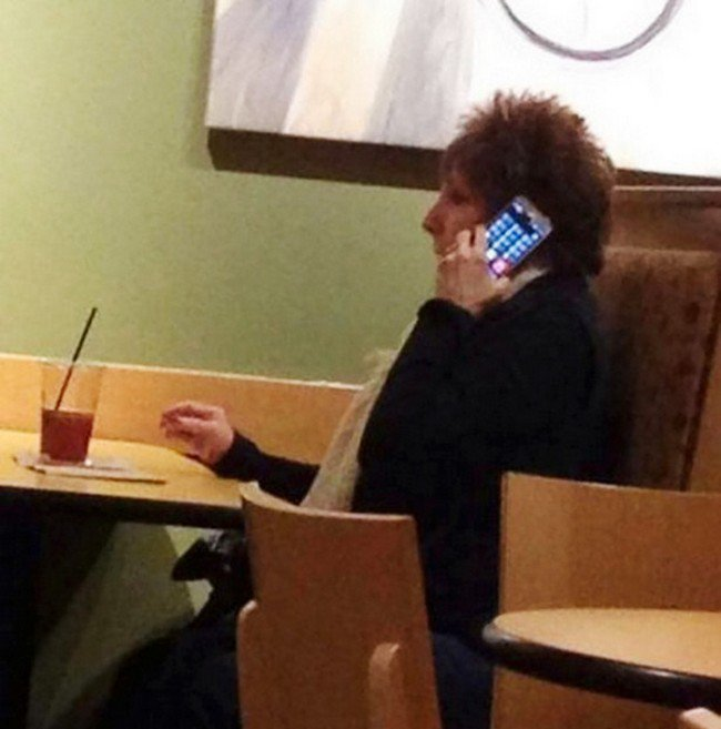 woman using phone wrongly