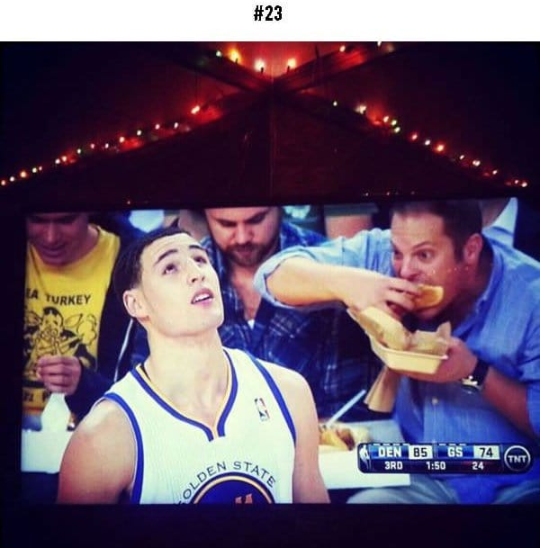 awkward sports moments guy eating food in background