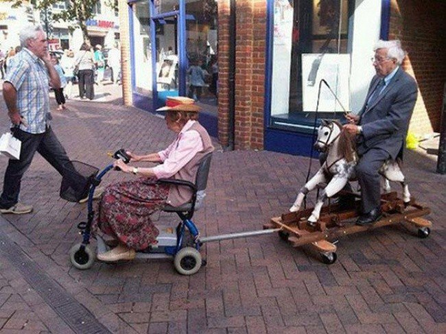 bizarre photos man woman rocking horse