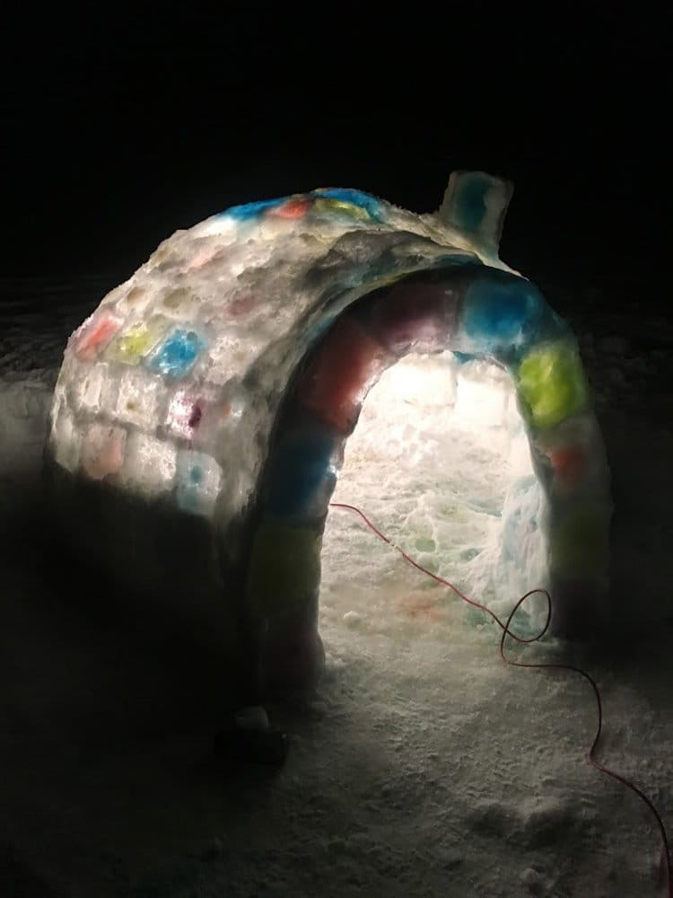 building an igloo glowing with lights