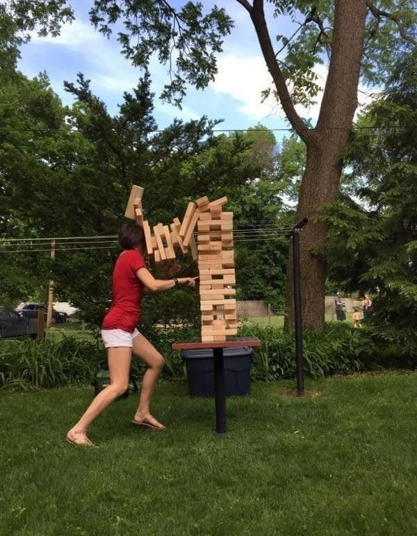 girl playing giant jenga