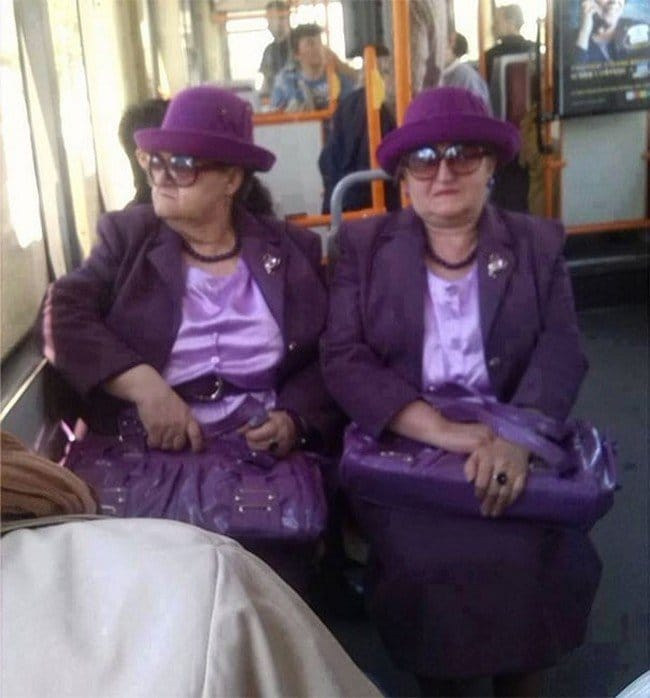 matrix glitches lookalike purple dressed ladies