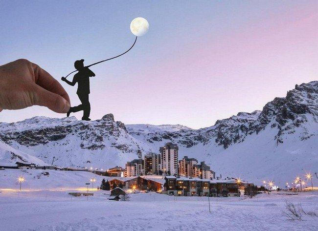 rich mccor paper cutout art man catching moon