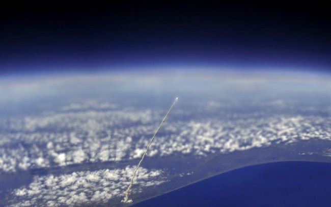 space shuttle atlantis view from space station