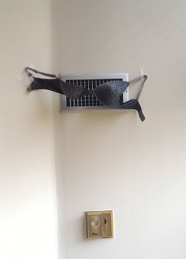 bra taped to walls to dry