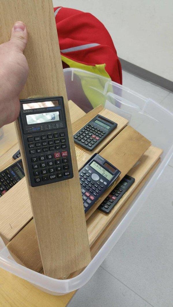 calculators stuck to wood