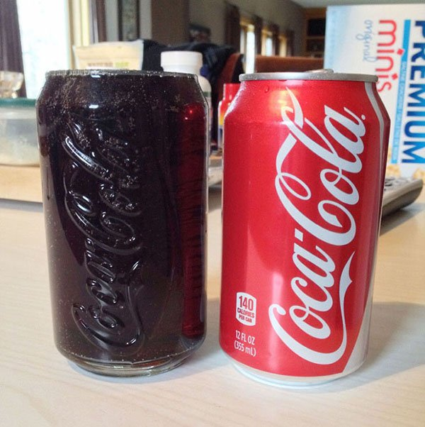 coke can filling up coke glass perfectly