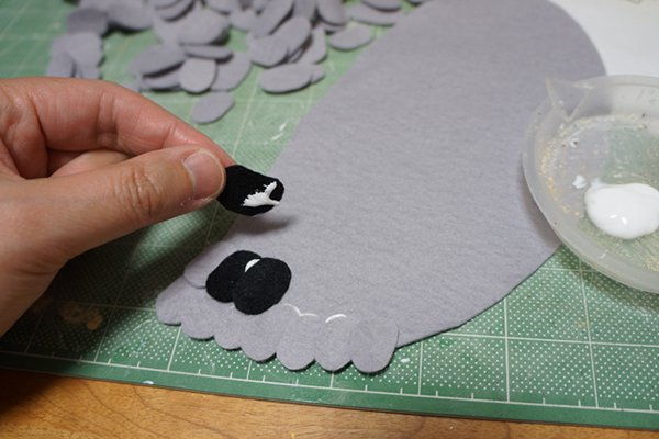 details being added to pigeon shoes
