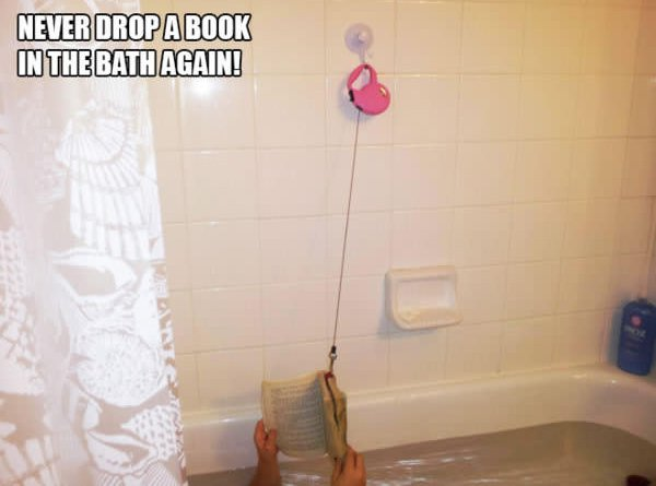 dog lead hold book in bath