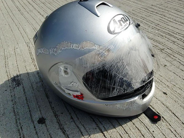 face scratched helmet