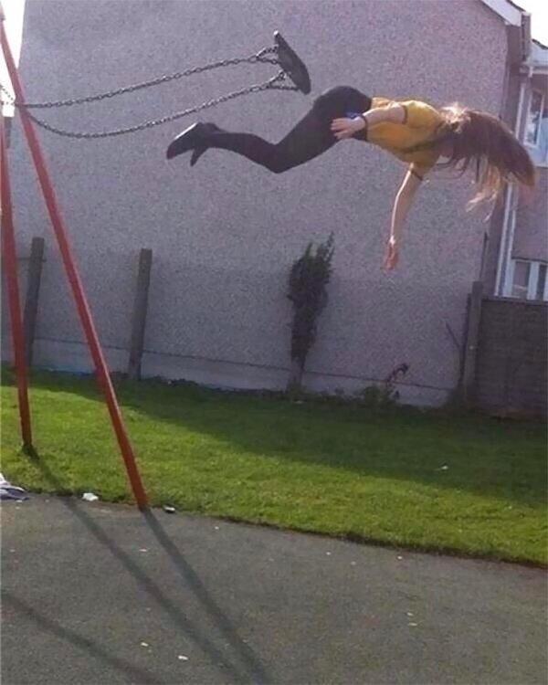 girl falling off of swing
