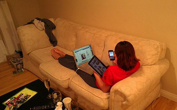 girlfriend on phone tablet and laptop