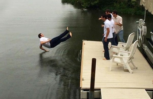 guy about to fall in lake