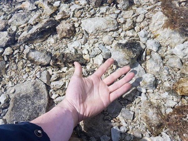 hand in really clear water