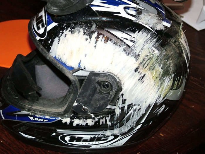 heavily scratched bike helmet