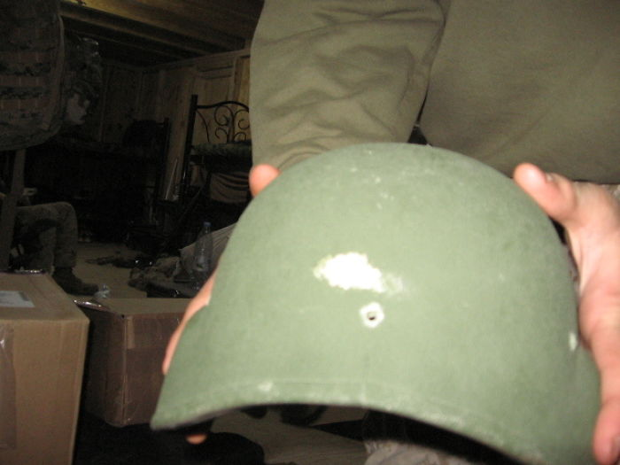 helmet with bullet hole