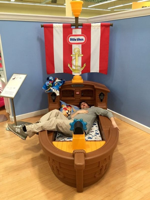 husband napping in toddler bed