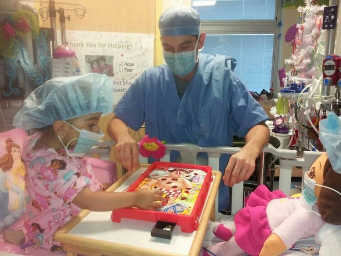 little girl playing operation in hospital