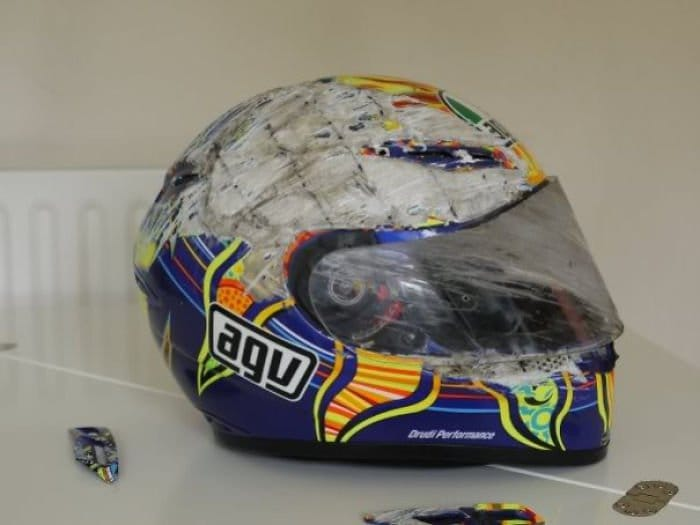severely damaged bike helmet