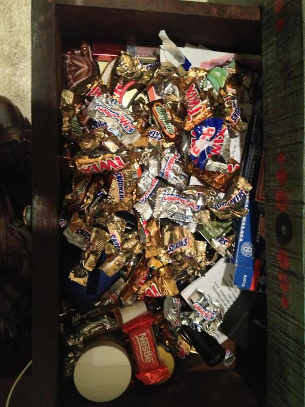 wife naught drawer filled with wrappers