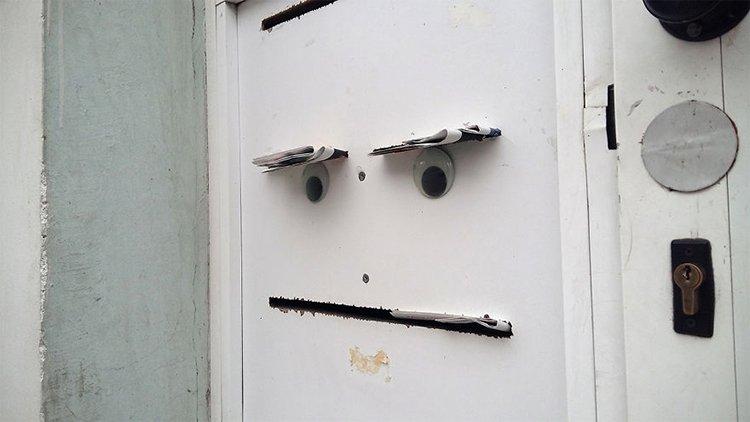 googly eyes on broken things door