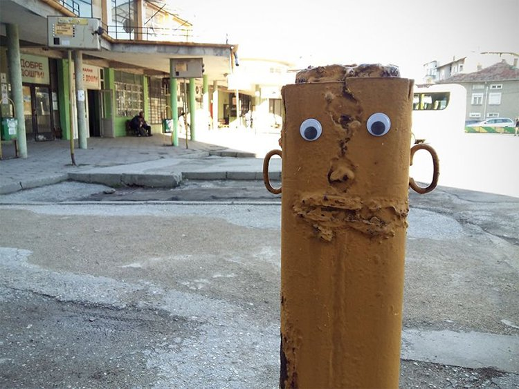 googly eyes on broken things face on post