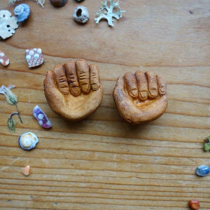 Artist Carves Avocado Pits hands